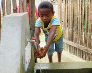 MDG112_VOLOLONA-RAVONINJATOVO_Boy-washing-his-hands_IMG1-Hero.jpg